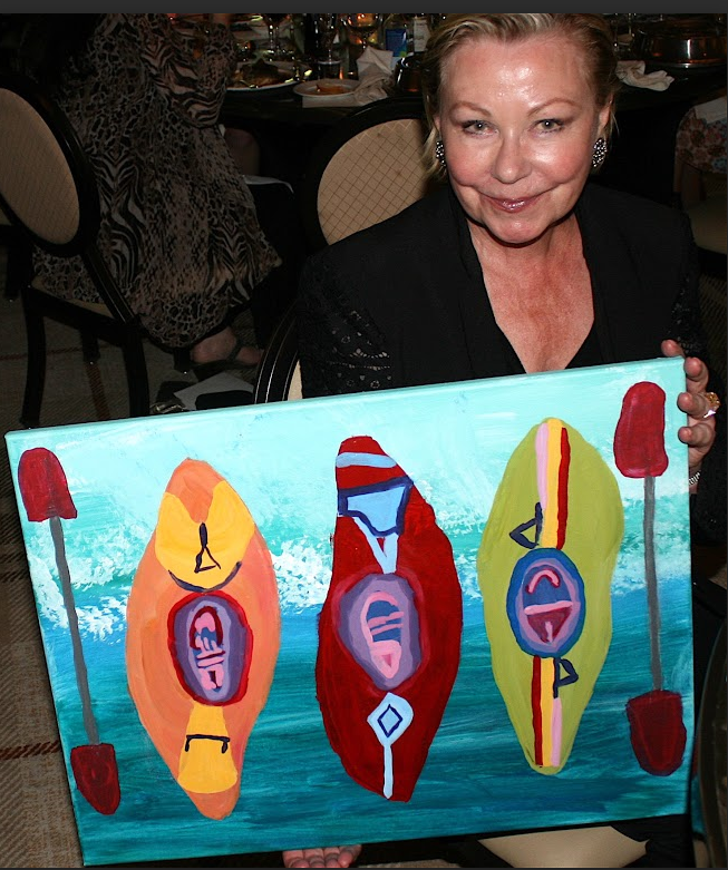 Ursula Miller with original art work presented as a gift from UCPNB to honor her work as the founder of Popskids